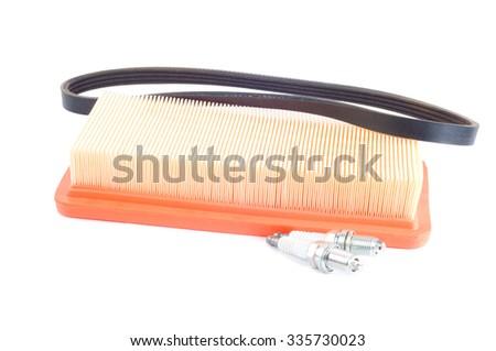 auto parts timing belt filter spark plug - stock photo