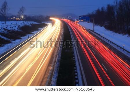 autobahn at sundown in winter - stock photo