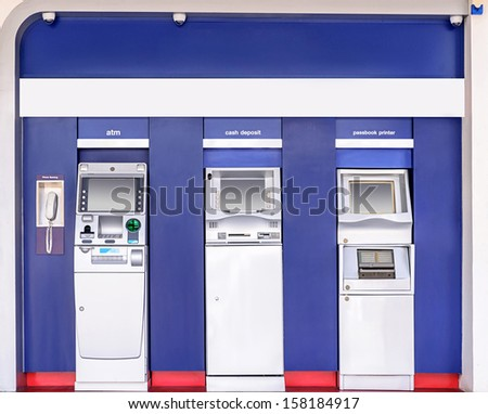 Automatic banking service point on the wall outside building. - stock photo