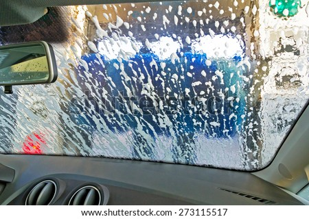 Automatic Car Wash from inside the windscreen soapy  - stock photo