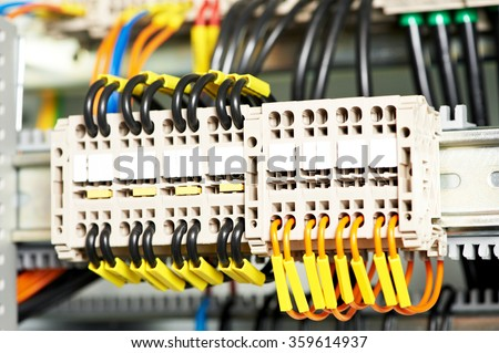 Automatic electrical connector switch in power lines located inside of an industrial switch control panel board. Shallow DOF - stock photo