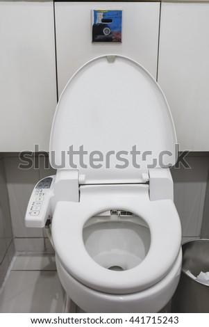 Automatic flush toilet, high technology of the toilet bowl. - stock photo