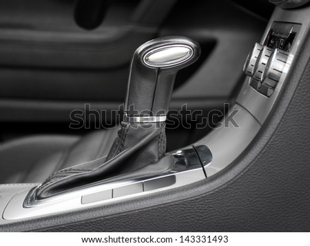 automatic gear shift in car - stock photo