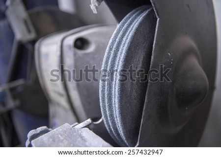 Automatic grinding machine at a blacksmith's workshop - stock photo