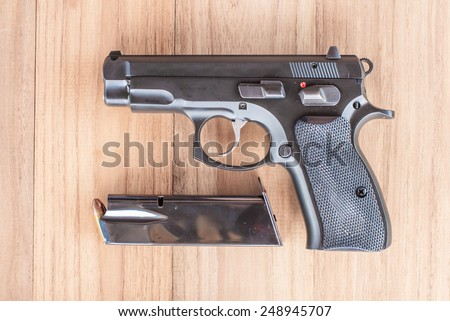 Automatic gun and bearing,CZ 75 compact. - stock photo