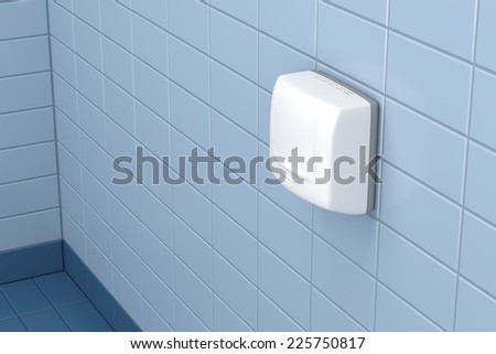 Automatic hand dryer in public toilet - stock photo