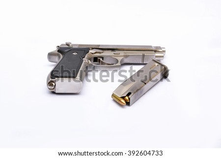 Automatic handgun pistol with magazine and bullets on white background - stock photo