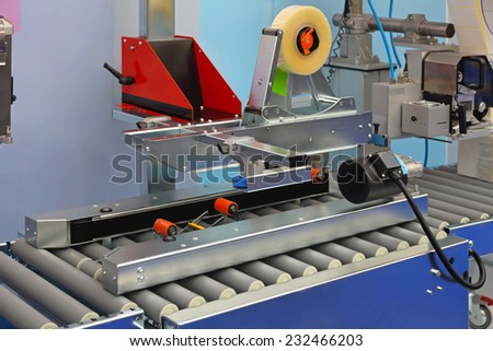 Automatic packing machine for boxes in factory - stock photo