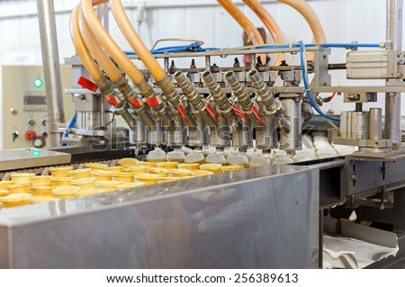 Automatic production line of ice cream - stock photo