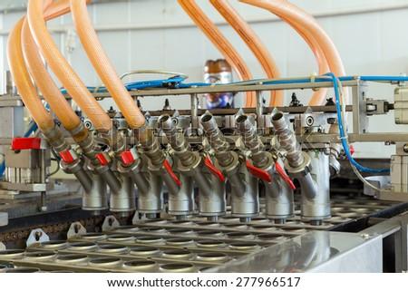 Automatic production line of ice cream - stock photo