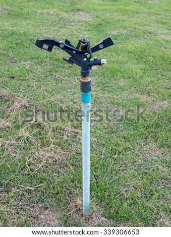 Automatic sprinkle in the lawn of urban park. - stock photo