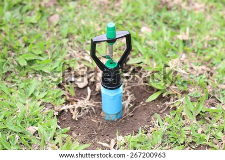 Automatic sprinkler watering in garden - stock photo