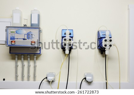 Automatic station water disinfection in swimming pool - stock photo