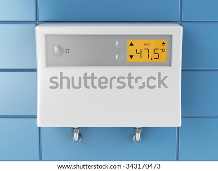 Automatic water heater attached on blue tiled wall - stock photo