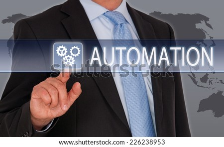 Automation - Businessman with touchscreen - stock photo