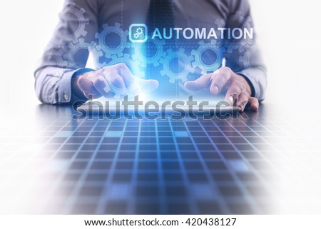 Automation concept. Businessman using futuristic tablet computer, pressing button on the touch screen and selecting icon with Automation concept.  - stock photo