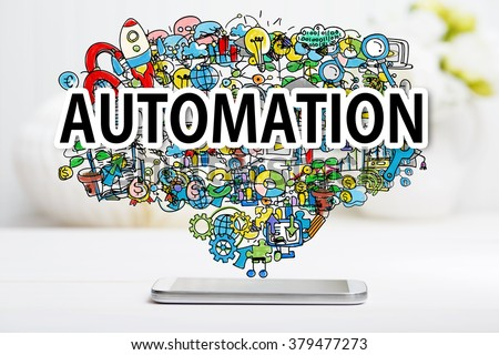 Automation concept with smartphone on white table - stock photo
