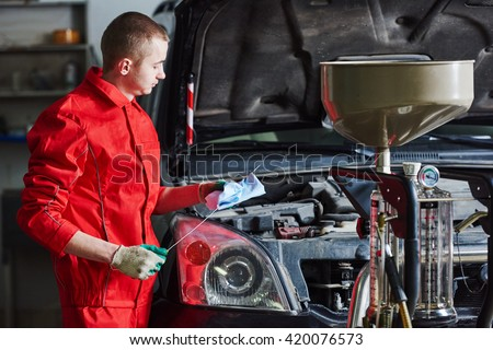 automobile car oil replacement work - stock photo