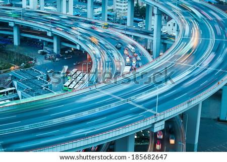 automobile motion blur on the bridge approach  - stock photo