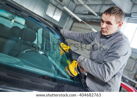 automobile windshield or windscreen replacement - stock photo