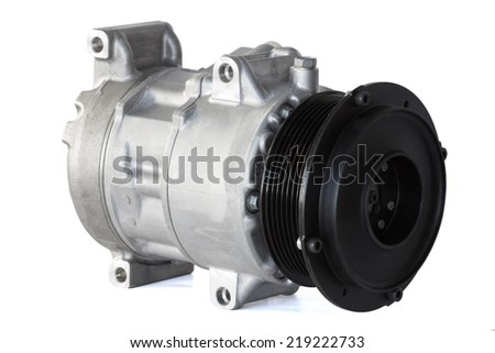 automotive air conditioning compressor on a white background - stock photo