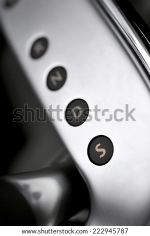 Automotive detail Gear Shift Indicator in a luxury car  - stock photo