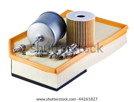 automotive spark plugs and filters isolated on white - stock photo