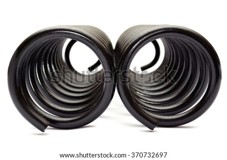 Automotive suspension coil spring on the white background  - stock photo