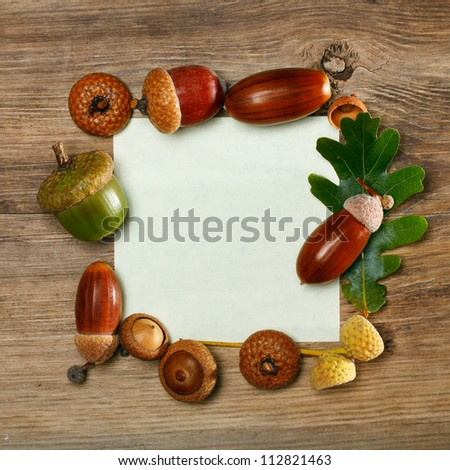 Autumn acorn frame with copy-space - stock photo