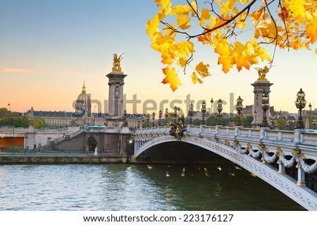 autumn Alexandre III Bridge at sunset,  Paris, France - stock photo
