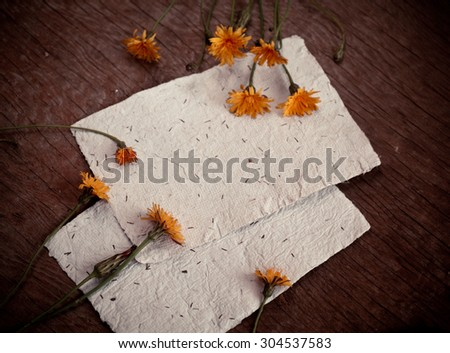 Autumn background with colorful yellow dandelion flowers on wooden background. Fall theme, Autumn concept background with yellow flowers and copy space - stock photo