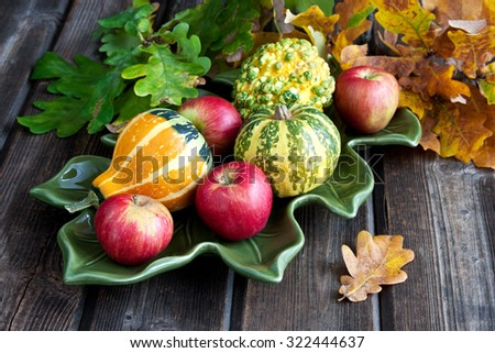 Autumn background with pumpkins  and apples on wooden board - stock photo