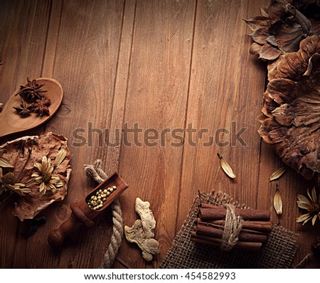 autumn background with  spices with dried flowers place for inscription - stock photo
