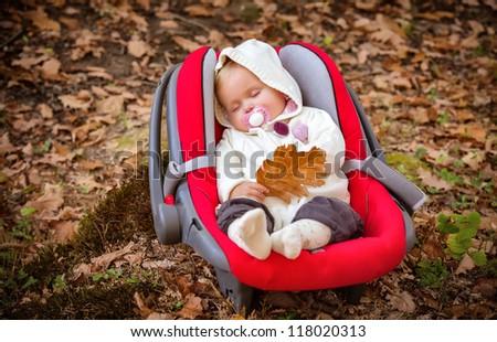 Autumn beautiful baby sleeping. Close up portrait. - stock photo