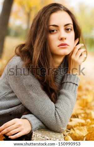 Autumn beautiful woman on leafs background - stock photo