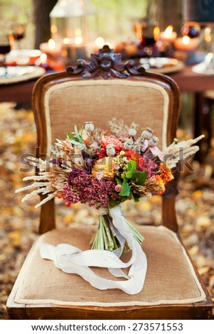 autumn bouquet on the vintage chair - stock photo