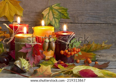 Autumn candles with leaves vintage abstract still life in night - stock photo