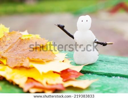 Autumn cold snap. Winter snowman. first snow - stock photo