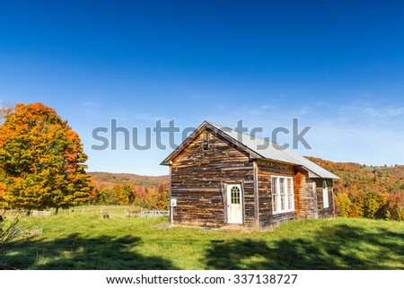 Autumn color and old barn in Vermont countryside - stock photo