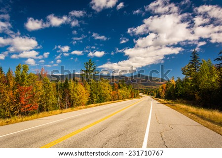 Autumn color on Owls Head Highway in White Mountain National Forest, New Hampshire. - stock photo