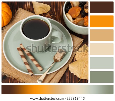 Autumn Concept. Cup Of Tea Or Coffee. Dried Fruits. Chocolate Sweets. Wooden Background. Palette With Complimentary Colour Swatches. - stock photo