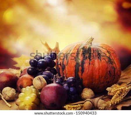 Autumn concept with seasonal fruits and vegetables - stock photo