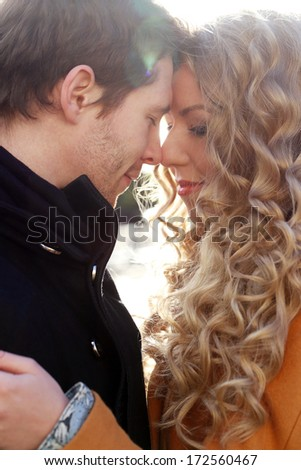 Autumn. Cute couple in the park - stock photo
