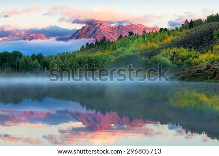 Autumn dawn at Oxbow Bend on the Snake River in Wyoming - stock photo