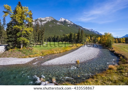 Autumn day in the Canadian Rockies. Dry creek in Banff National Park - stock photo
