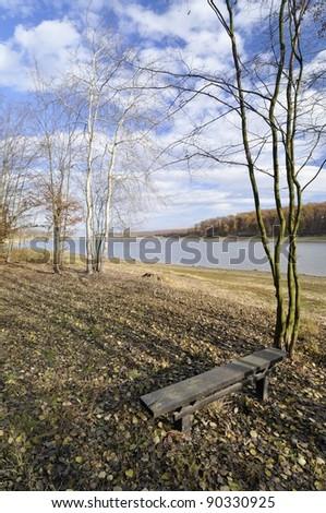 Autumn day on the lake shore - stock photo