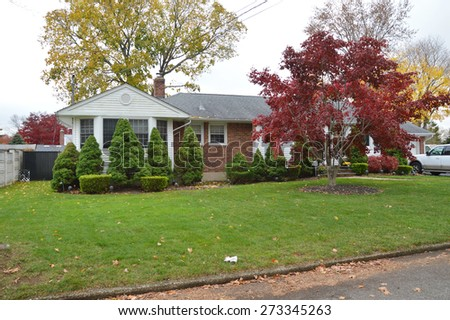Autumn Day Residential neighborhood Suburban Brick Ranch home USA - stock photo