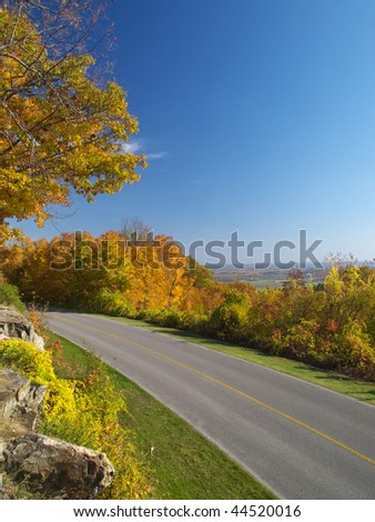 Autumn drive way in Gatineau Park, Hull, Canada - stock photo