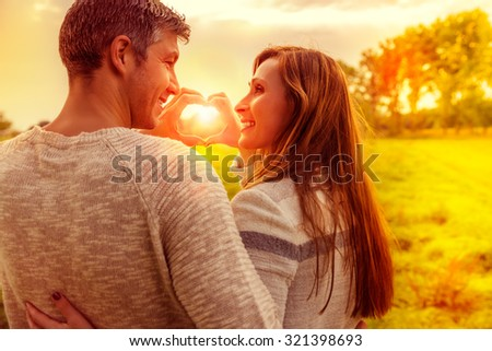 autumn fall lovers together looking horizon - stock photo