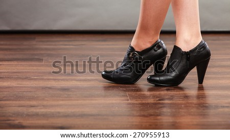 Autumn fashion. Female legs foots in stylish fashionable shoes boots - stock photo